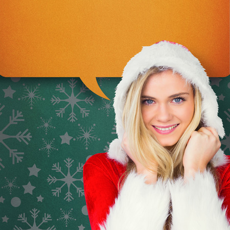 Pretty girl smiling in santa outfit against green vignette photo