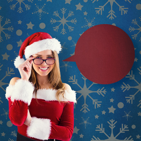 Sexy santa girl wearing spectacles against blue vignette photo