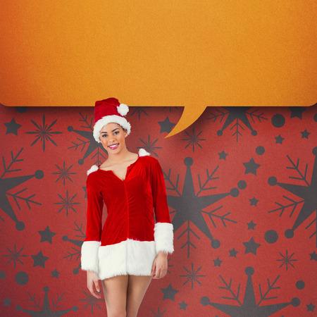 Pretty santa girl smiling at camera against orange photo