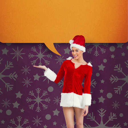 Pretty santa girl presenting with hand against pink vignette photo