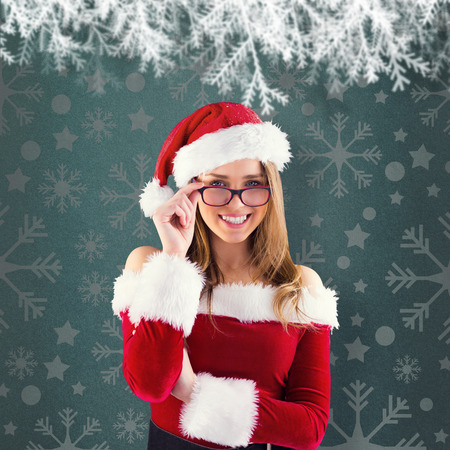 Sexy santa girl wearing spectacles against green vignette photo