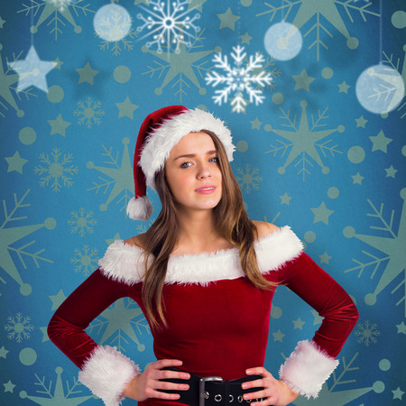 Sexy santa girl smiling at camera against blue vignette photo