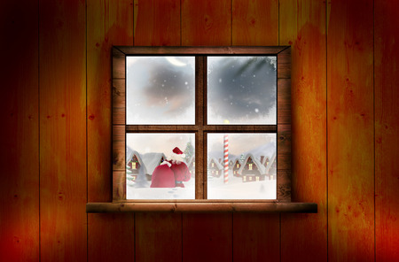 north pole: Santa delivery presents to village against window in wooden room