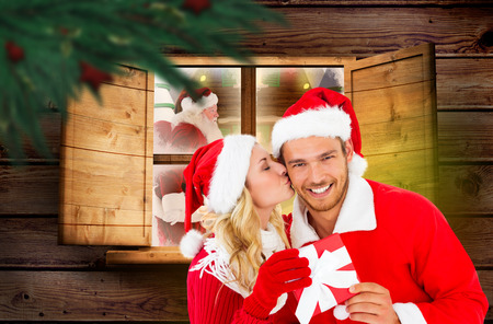 Young festive couple against festive fir branch with baubles photo