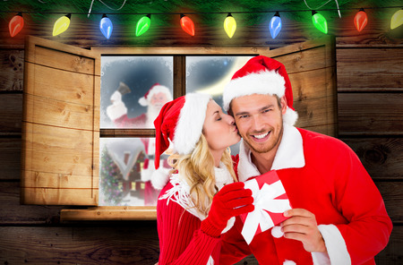 Young festive couple against fir branch christmas decoration garland photo