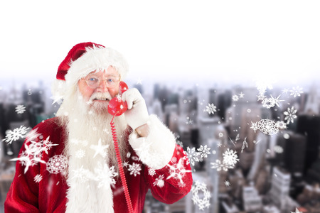 Santa claus on the phone against high angle view of city photo