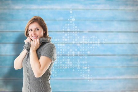 Pretty girl in jumper against blurred wooden planks