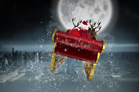 Santa flying his sleigh against balcony overlooking city