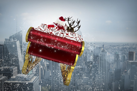 Santa flying his sleigh against cityscape