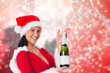 Woman holding a champagne bottle against blurred lights photo