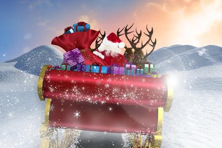 blue santa: Santa flying his sleigh against digitally generated snowy land scape