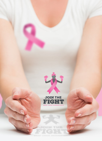 fighting cancer: Woman presenting breast cancer awareness message in her hands
