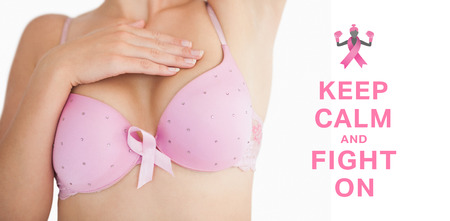 breast examination: Woman in bra with breast cancer awareness ribbon against breast cancer awareness message Stock Photo