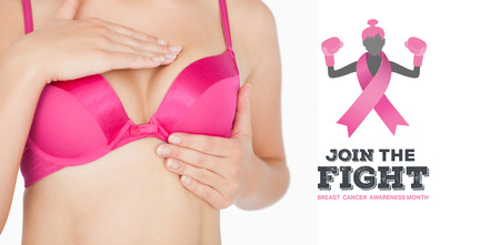 fighting cancer: Woman performing self breast examination against breast cancer awareness message