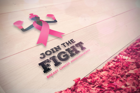 fighting cancer: Breast cancer awareness message against autumn leaves against white wood