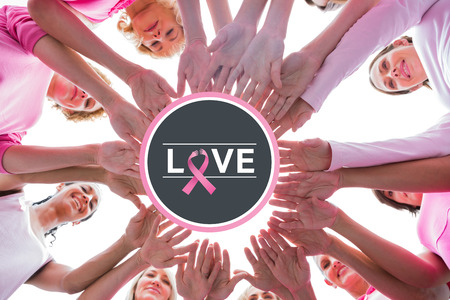 breast cancer awareness ribbon: Happy women in circle wearing pink for breast cancer against breast cancer awareness message on poster