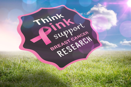 Breast cancer awareness message against sunny landscape Stock Photo