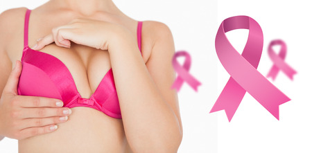 breast examination: Closeup of woman performing self breast examination against pink breast cancer awareness ribbons