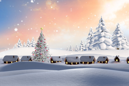 Snow covered village against snowy landscape with fir trees photo