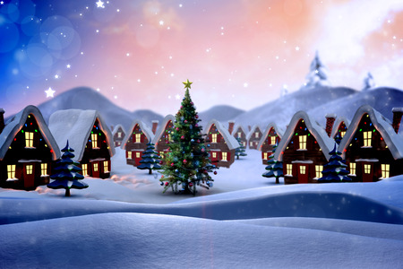 Cute christmas village against snowy landscape with fir trees photo