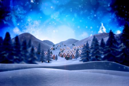 Leuke kerst dorp tegen een besneeuwde landschap met dennen Stockfoto