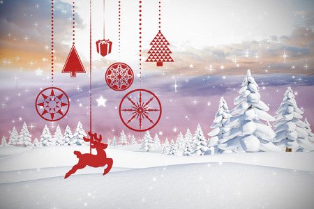 twinkling: Hanging red christmas decorations against twinkling stars Stock Photo