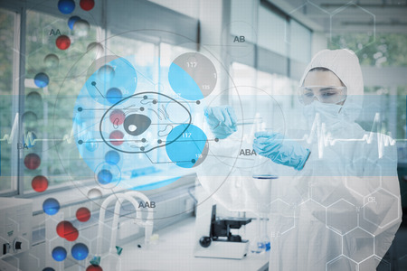 Scientist in protective suit working with cell diagram interface against dna helix in blue and red with ecg line photo