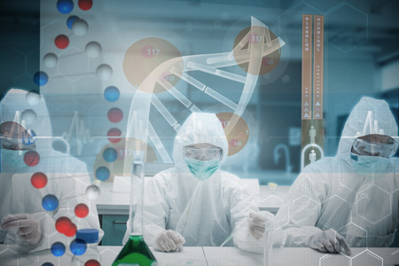 Scientists working in the lab with futuristic interface  against dna helix in blue and red with ecg line Stock Photo