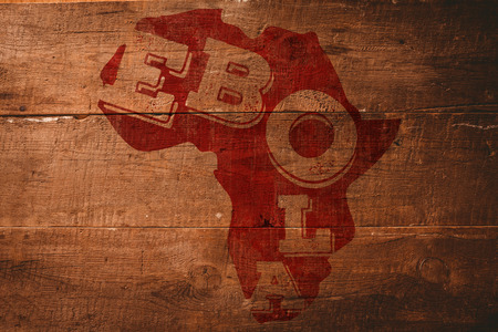 africa outline: Red ebola text on africa outline against overhead of wooden planks