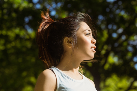 body concern: Side view of healthy and beautiful young woman in park Stock Photo