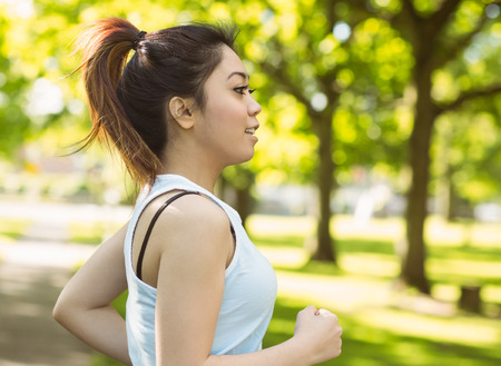 body concern: Healthy and beautiful young woman jogging in park