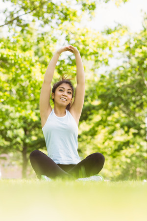body concern: Full length of healthy and beautiful young woman stretching hands in park Stock Photo