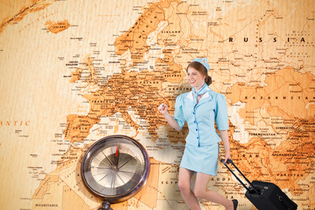 Pretty air hostess pulling suitcase against world map with compass pretty air hostess pulling suitcase against world map with compass showing europe and the middle east gumiabroncs Choice Image