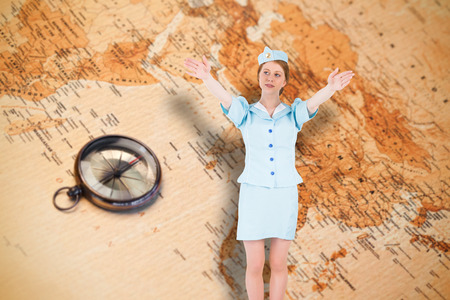 exits: Pretty air hostess with arms raised against world map with compass showing southern asia Stock Photo