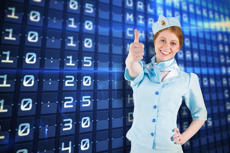 departures board: Pretty air hostess with hand on hip against blue departures board for major usa cities