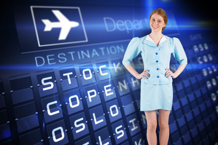 departures board: Pretty air hostess smiling at camera against blue departures board for nordic cities