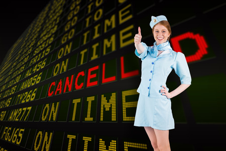 departures board: Pretty air hostess with hand on hip against black airport departures board