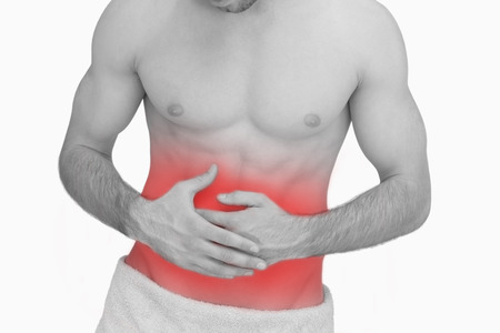 man stomach ache: Midsection of man with stomach ache over white background