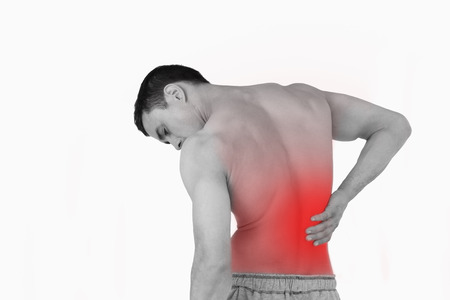 Back view of man suffering from back pain against a white background photo