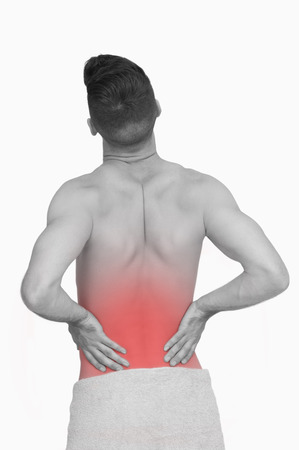 back sprains: Rear view of shirtless man with back pain over white background