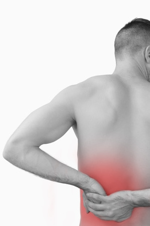 back sprains: Rear view of shirtless man with backache over white background Stock Photo