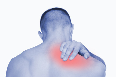 Rear view of shirtless man with neck pain over white background photo