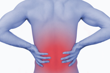 lower back: Rear view of muscular man with backache over white background Stock Photo