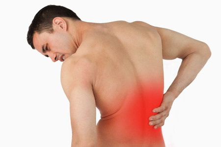 chronic back pain: Back view of male suffering from back pain against a white background Stock Photo
