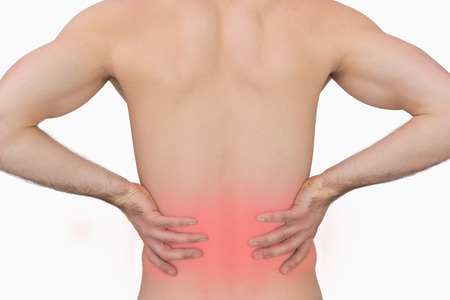backache: Rear view of muscular man with backache over white background Stock Photo