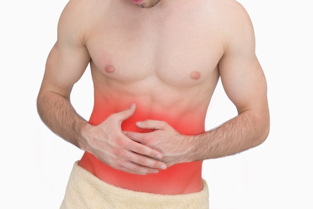stomach ache: Midsection of man with stomach ache over white background