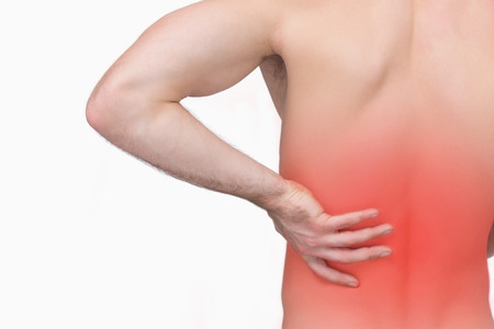 back sprains: Rear view of shirtless man with hand on hip over white background