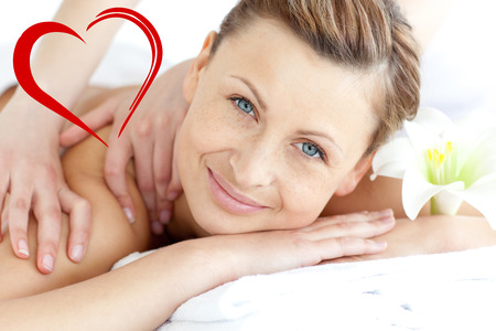 delighted: Delighted woman enjoying a back massage against heart