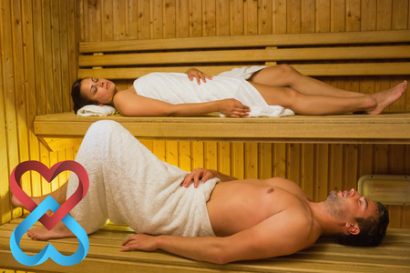 linking together: Calm couple relaxing in a sauna against linking hearts