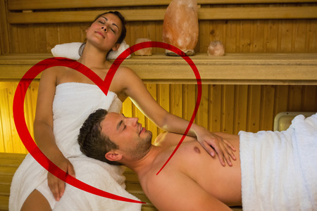 lap of luxury: Loving couple relaxing in a sauna against heart